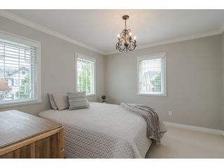"""Photo 21: 6969 179 Street in Surrey: Cloverdale BC House for sale in """"Provinceton"""" (Cloverdale)  : MLS®# R2460171"""