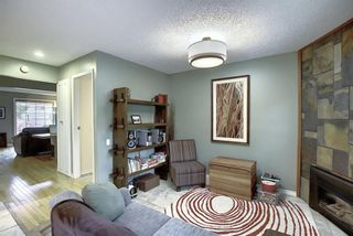 Photo 3: 373 Point Mckay Gardens NW in Calgary: Point McKay Row/Townhouse for sale : MLS®# A1063969