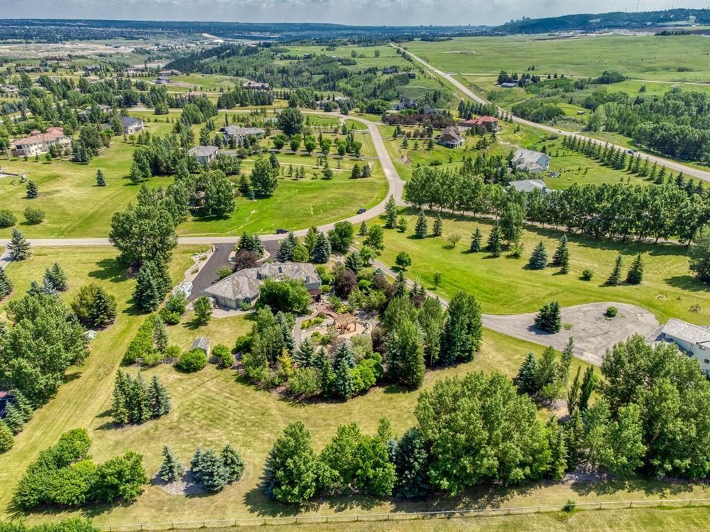 """2.03 acre jewel box country residential estate featuring a breathtaking west facing """"Butchart Gardens"""" inspired outdoor retreat, extensive lawn areas, 3 car garage & immaculate 4 bed walkout bungalow."""