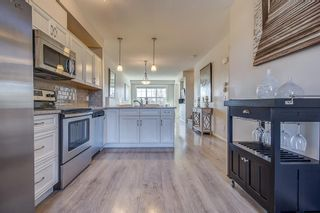 Photo 5: 100 Legacy Main Street SE in Calgary: Legacy Row/Townhouse for sale : MLS®# A1095155