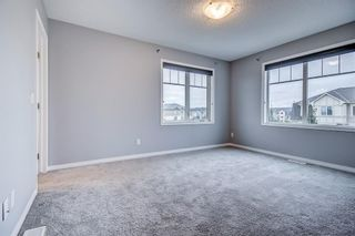 Photo 32: 129 Windstone Park SW: Airdrie Row/Townhouse for sale : MLS®# A1137155