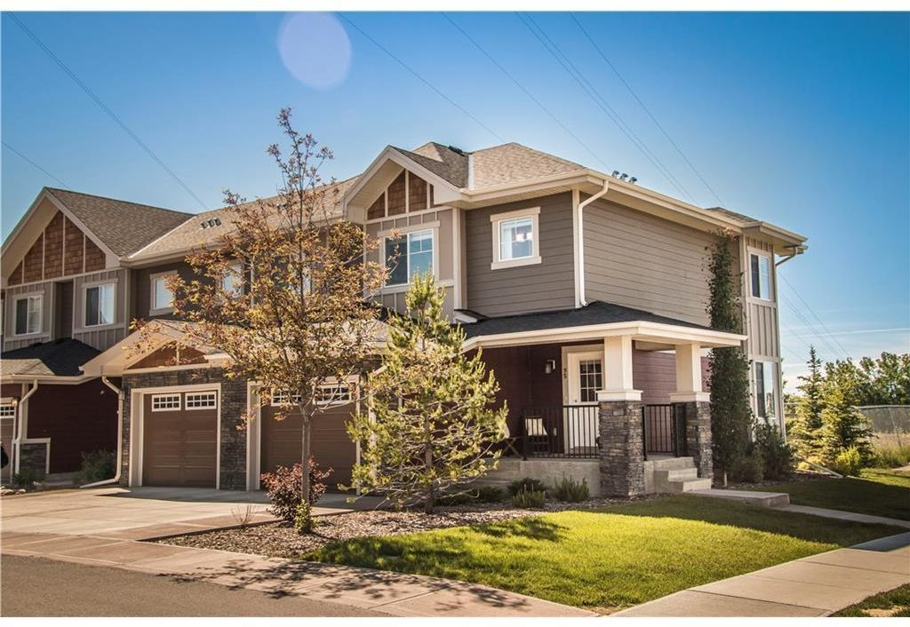 Main Photo: 95 West Coach Manor SW in Calgary: West Springs Row/Townhouse for sale : MLS®# A1114599