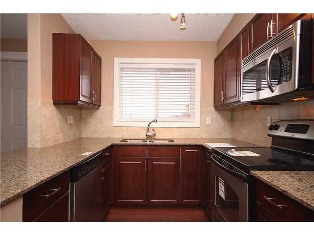 Photo 6: Photos: 1 605 67 Avenue SW in CALGARY: Kingsland Condo for sale (Calgary)  : MLS®# C3424392