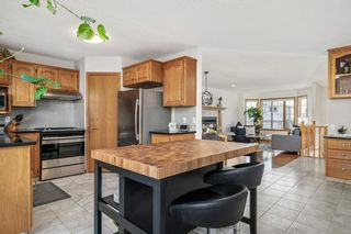 Photo 12: 92 Arbour Glen Close NW in Calgary: Arbour Lake Detached for sale : MLS®# A1066556