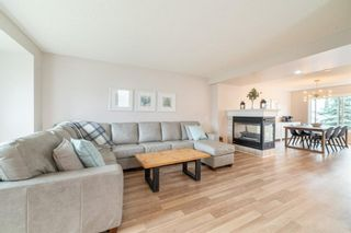 Photo 4: 107 Tuscany Valley Drive Drive in Calgary: Tuscany Detached for sale : MLS®# A1135178