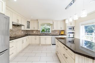 """Photo 19: 7464 149A Street in Surrey: East Newton House for sale in """"CHIMNEY HILLS"""" : MLS®# R2602309"""