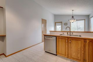Photo 16: 60 Woodside Crescent NW: Airdrie Detached for sale : MLS®# A1110832