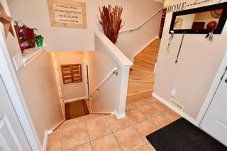 Photo 15: 748 Carriage Lane Drive: Carstairs House for sale : MLS®# C4165695