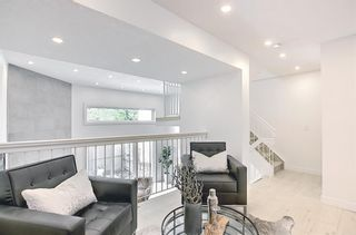 Photo 7: 64 Glamis Gardens SW in Calgary: Glamorgan Row/Townhouse for sale : MLS®# A1112302