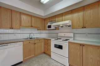 Photo 8: 6807 Pinecliff Grove NE in Calgary: Pineridge Row/Townhouse for sale : MLS®# A1121395