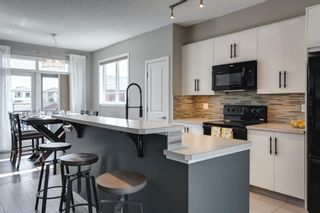 Photo 8: 604 Walden Circle SE in Calgary: Walden Row/Townhouse for sale : MLS®# A1083778