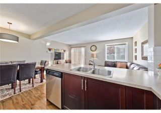 Photo 8: 232 PANTEGO Lane NW in Calgary: Panorama Hills Row/Townhouse for sale : MLS®# A1096054