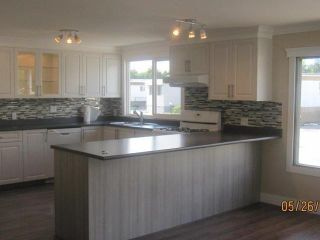 """Photo 5: 307 201 CAYER Street in Coquitlam: Maillardville Manufactured Home  in """"WILDWOOD PARK"""" : MLS®# V1068018"""