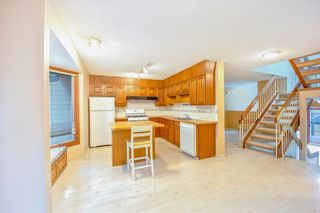 Photo 9: 7050 Edgemont Drive NW in Calgary: Edgemont Row/Townhouse for sale : MLS®# A1108400