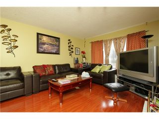Photo 2: 7731 CANADA Way in Burnaby: Edmonds BE House for sale (Burnaby East)  : MLS®# V1075205