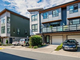 """Photo 1: 38367 SUMMITS VIEW Drive in Squamish: Downtown SQ Townhouse for sale in """"Eaglewind"""" : MLS®# R2616337"""