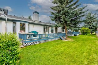 Photo 4: 34 Woodmeadow Close SW in Calgary: Woodlands Semi Detached for sale : MLS®# A1127227