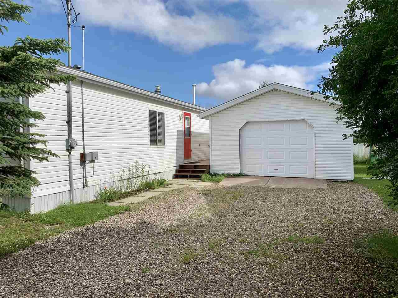 """Photo 5: Photos: 3935 COTTONWOOD Road in Fort Nelson: Fort Nelson -Town Manufactured Home for sale in """"EAST DUB"""" (Fort Nelson (Zone 64))  : MLS®# R2479630"""