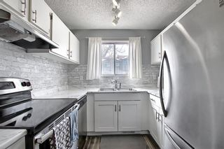 Photo 9: 104 7172 Coach Hill Road SW in Calgary: Coach Hill Row/Townhouse for sale : MLS®# A1097069