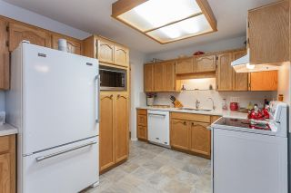 """Photo 4: 102 5375 205 Street in Langley: Langley City Condo for sale in """"GLENMONT PARK"""" : MLS®# R2335377"""