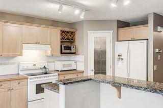 Photo 10: 324 Rocky Ridge Drive NW in Calgary: Rocky Ridge Detached for sale : MLS®# A1124586