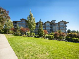 """Photo 1: 418 3110 DAYANEE SPRINGS BL in Coquitlam: Westwood Plateau Condo for sale in """"LEDGEVIEW"""" : MLS®# R2118967"""