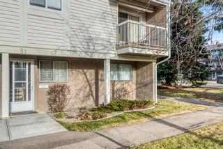 Photo 3: 51 3015 51 Street SW in Calgary: Glenbrook Row/Townhouse for sale : MLS®# A1054474