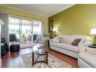 "Photo 2: 414 13860 70TH Avenue in Surrey: East Newton Condo for sale in ""Chelsea Gardens"" : MLS®# F1448214"