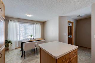 Photo 18: 105 Rocky Ridge Court NW in Calgary: Rocky Ridge Row/Townhouse for sale : MLS®# A1069587
