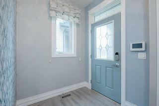 Photo 3: 48 Tremblant Terrace SW in Calgary: Springbank Hill Detached for sale : MLS®# A1131887