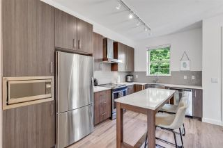 Photo 2: 18 433 SEYMOUR RIVER PLACE in North Vancouver: Seymour NV Townhouse for sale : MLS®# R2585787