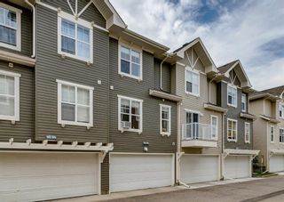 Photo 2: 311 Toscana Gardens NW in Calgary: Tuscany Row/Townhouse for sale : MLS®# A1133126