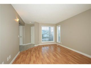 Photo 6: 74 WEST TERRACE Road: Cochrane House for sale : MLS®# C4073559