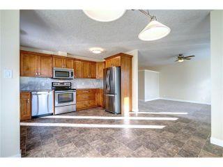 Photo 4: 106 Maplewood Place: Black Diamond House for sale : MLS®# C4042698