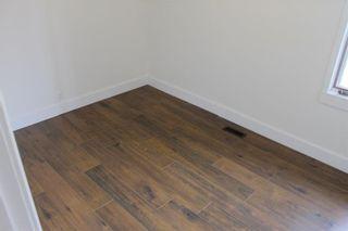Photo 16: 1014 Nanton Avenue: Crossfield House for sale : MLS®# C4123826