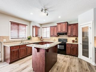 Photo 6: 26 TUSSLEWOOD View NW in Calgary: Tuscany Detached for sale : MLS®# C4296566