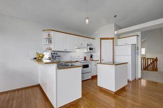 Photo 7: 26 HIDDEN RANCH Road NW in Calgary: Hidden Valley House for sale
