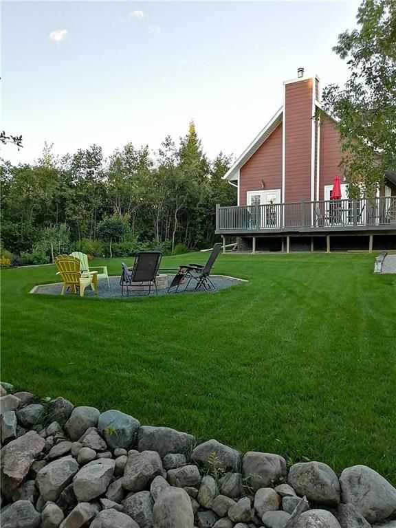 This yard is like a park, here is summer view.  Look what awaits!.
