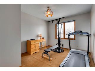 Photo 18: 27 COACHWOOD Place SW in Calgary: Coach Hill House for sale