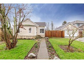 """Photo 2: 34680 2ND Avenue in Abbotsford: Poplar House for sale in """"HUNTINGDON VILLAGE"""" : MLS®# R2528448"""