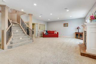 Photo 30: 227 Sunterra Ridge Place: Cochrane Detached for sale : MLS®# A1058667
