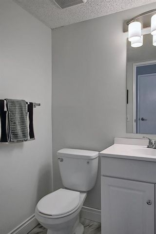 Photo 19: 104 7172 Coach Hill Road SW in Calgary: Coach Hill Row/Townhouse for sale : MLS®# A1097069
