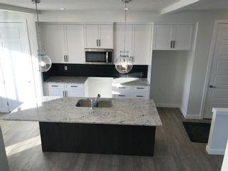 Photo 9: 11 Sundown Manor: Cochrane Semi Detached for sale : MLS®# A1071566