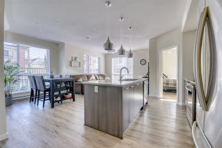 "Photo 1: A002 20087 68 Avenue in Langley: Willoughby Heights Condo for sale in ""PARK HILL"" : MLS®# R2536796"