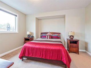 Photo 13: 113 ROCKFORD Road NW in Calgary: Rocky Ridge House for sale : MLS®# C4079306
