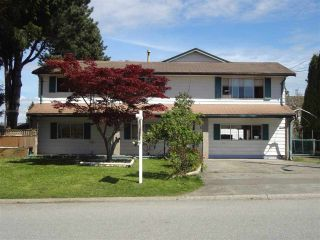 Photo 1: 8194 134 STREET in Surrey: Queen Mary Park Surrey House for sale : MLS®# R2161485