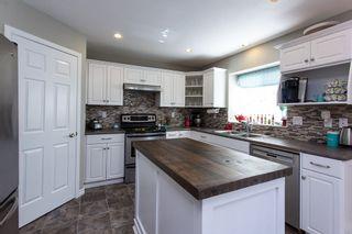 "Photo 2: 9444 202B Street in Langley: Walnut Grove House for sale in ""Riverwynde"" : MLS®# R2182423"