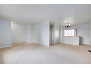 Photo 8: 3039 CANMORE Road NW in Calgary: Banff Trail House for sale