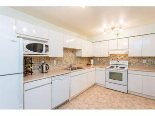 Photo 5: 404 3065 PRIMROSE LANE in Coquitlam: North Coquitlam Condo for sale : MLS®# R2428749