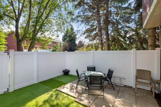 Photo 24: 14 Queen Anne Close SE in Calgary: Queensland Row/Townhouse for sale : MLS®# A1146388
